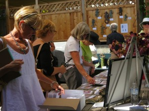 guests browsing cards and checking out Nancy's seahorses